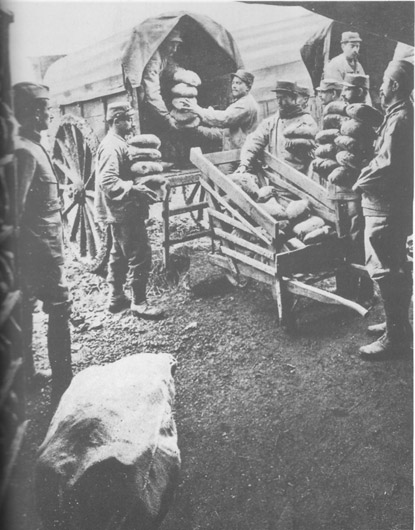 Bread produced by field bakeries being distributed to the 'cooks'.