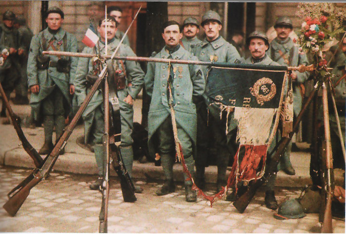 These men pose with their regimental flag in a rare color photo.