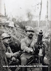 A soldier prepares to fire a trench mortar or
