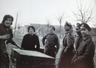 A group of Russian soldiers of the Russian Legion bargain over prices with two French ladies. Photo taken by Frantz Adam, near Viller-Franqueux, March 1917.