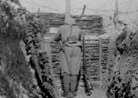 Barbed-wire can be seen stretched across a trench to defend against infiltrators.