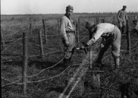 Soldiers setting up barbed-wire entanglements for a support position behind the front lines.