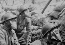 Men of the 48 RI donning M2 gas masks in the spring of 1916.