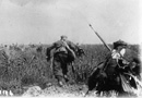 An actual combat photo of zouaves advancing under fire in 1918.