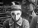A group of soldiers pose with their gas masks, 1915.