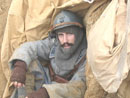 Sgt. Contamine in a small shelter dug into trench wall - Newport News, VA, March 2005