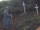 Sgt. Contamine cleans up our scared grounds: Justin Hoover's grave and the unit memorial to the French soldiers of the Great War, November 2011.